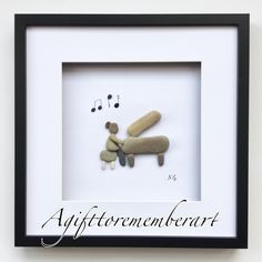 """The Pianist"" a beautiful custom-made design for a lovely customer #agifttorememberart #pebbleart #piano #musician #art #handmade #instaart #instaphoto #instagood #gift #etsy #etsyseller #makersgonnamake #craft #frame #interiordesign #roomdecor #australia #beach #stone #music #customemade #nature #recycledart #photooftheday"