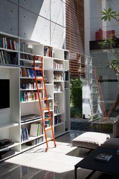 bookshelves & orange ladders