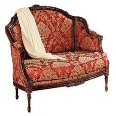 """French salon-style loveseat with a hand-carved hardwood frame and floral-print upholstery.        Product: Loveseat    Construction Material: Solid hardwood and fabric    Color: Red     Features:   Hand-carved   Hand-upholstered   Antique replica           Dimensions: 40"""" H x 45"""" W x 32"""" D"""
