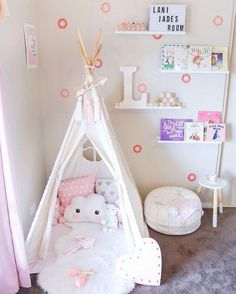 Little girls room. Reading nook teepee with soft rugs and pillows