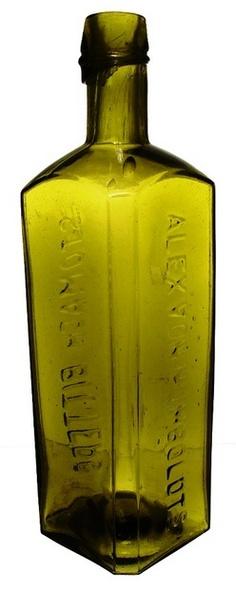 Alex Vonhumboldts Stomach Bitters, Green, 10 inch. An Alex Vonhumboldts Stomach Bitters bottle in green
