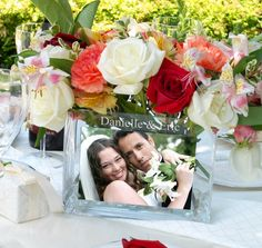 Wedding Reception Glass Photo Vase. These are just the cutest Im getting these for my reception tables.