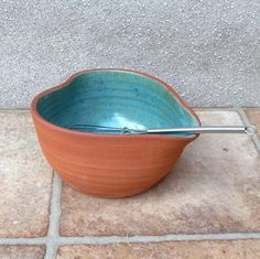 Salad dressing mixing and pouring bowl .......hand thrown terracotta pottery