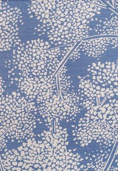 Woodsford Linen Fabric Pale Sapphire Linen fabric with large white floral print. Suitable for Upholstery, Curtains and Soft Furnishings.  Fabricsandpapers.com