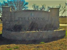 The one and only entrance to The Landing on Boat Club Road.