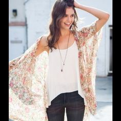 Brandy Melville kimono Very light shawl with flower pattern that could be topped over a bathing suit or a cute summer outfit. Worn once-perfect condition Brandy Melville Sweaters Cardigans
