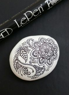 ••• Alaska Art Stones ••• Are baaaack! I have brought these puppies out of semi-forced-retirement (I ran out of rocks while there was snow on the ground). Painted with white paint and drawn on with LePen Permanent Art Pen.