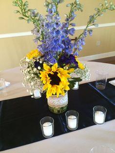 Reception decor. Summer wedding. Centerpiece. Sunflower. Delphinium. Baby's breath. Mason jar. Burlap. Lace. Country chic.