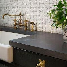 Black Kitchen Cabinets with White Moorish Tile Backsplash