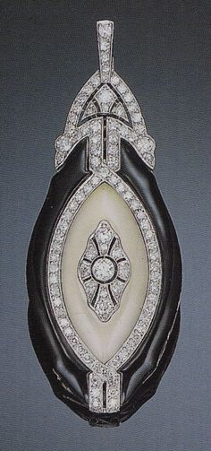 An Art Deco diamond and enamel lorgnette. The lorgnette pendant of oblong shape and geometric patterning of diamonds, black enamel and white chalcedony, opening to reveal a pair of eye glasses, mounted in platinum. Source: Christie's catalogue, Sale 9400, Important Jewelry, 29 March 2000, Los Angeles.