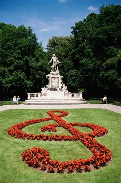 Statue of Mozart, Vienna. How appropriate that there is a treble clef shaped garden in front of Mozart's statue.