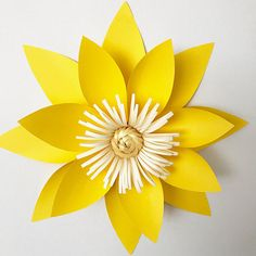 Beautiful paper flower template (PDF) from The Crafty Sagittarius. Size range from 6 inches to 12 inches.