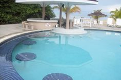 The pool at Sunset Beach, Couples Sans Souci in Ocho Rios, Jamaica - yo, Jen - that IS a swim-up bar....