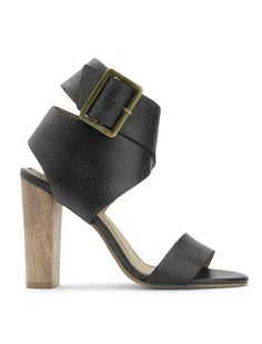 """The sky's the limit in the Jayla Sandal  Chic leather sandal takes you from day to night  Gorgeous leg lengthening effect    High heel sandal  Twisted ankle strap with oversize buckle detail  Straight toe strap  3 1/4"""" strap"""