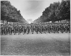 "American troops of the 28th Infantry Division march down the Champs Elysees, Paris, in the ""Victory"" Parade., 08/29/1944"