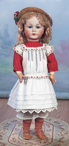 """Gentle-Faced German Bisque Character """"Mein Liebling"""" by Kammer and Reinhardt  20"""" (51 cm.) Marks: K*R Simon & Halbig 117/A 50. Comments: Kammer and Reinhardt,circa 1912,marketed as """"Mein Susser Liebling"""" (my sweet darling),from their character series. Value Points: very sweet child with pretty yet characterized expression,lovely bisque and painting,original body finish,wonderful antique costume."""