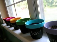 DIY Chalkboard and acrylic painted clay pots for herb garden.  Krylon Chalkboard paint with a sponge brush for outside, Acrylic Paint for inside and outside rims.