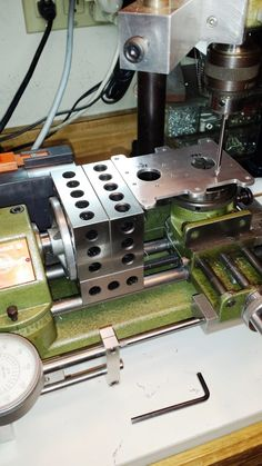 Using 1-2-3 blocks snug against Unimat lathe faceplate to align a part clamped in the 48-position dividing head. The blocks are removed before starting indexing for drilling two set of six evenly space holes. The holes are for threaded studs that will connect a compound steam engine cylinder head to an entablature that supports the cylinders above the crankshaft.