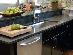 Kitchen, Astounding Black Granite Countertop On Black Kitchen Cabinet Kitchen Sink With Single Rectangular Bowl Raised Breakfast Bar: Five General Categorical Options of Kitchen Countertops for Beauty and Durability