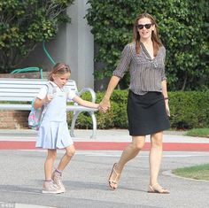 Happy days: Jennifer Garner certainly had a spring in her step and a smile on her dial as she ran about Santa Monica, California, on Monday with daughter Seraphina