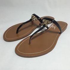 TORY BURCH T LOGO FLAT THONG SANDALS – SZ 9.5 Authentic Tory Burch T Logo Flat Thong Sandals. New without box; size 9.5. Black patent saffiano leather straps with polished gold-tone T Logo at top. Please be familiar with sizing of Tory Burch footwear. ❌❌NO TRADES NO PP PLEASE DO NOT ASK❌❌ Tory Burch Shoes Sandals