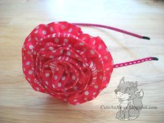 """No-Sew flower.  1"""" felt circle, about 3 yards of 1/2"""" to 1"""" wired ribbon.  Gather and glue as you go, starting on outer edge.  Tuck and scrunch in center, securing with glue."""