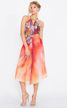 407ce9f5497b The Birds of a Feather Jumpsuit features an abstract printed halter  jumpsuit with culotte pants. Features a large keyhole opening on back with  a self tie ...