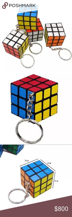 Rubiks Cube Keychain New in package. Attach this fun accessory to a bunch of keys or bag. The cube really turns and twists.   ▫️Brain teaser  ▫️Size: 3cm  ⭐️⭐️⭐️⭐️⭐️ 5 star rated item ⬛️ Posh Ambassador ◼️ 600+ Sales  🔳 No Trades Accessories Key & Card Holders
