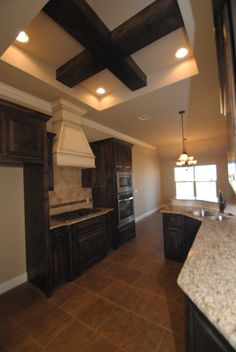 Awesome kitchen in this new built home in Edmond, OK with wood beamed ceilings, stainless steel appliances and granite counter tops.  http://www.lapatterson.com/
