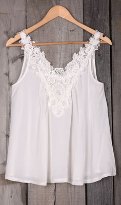 This super cute top should be the main attraction of your summer festival look. Simple and sweet with a little lace flower. Perfect for wearing with everything from joggers to leggings.