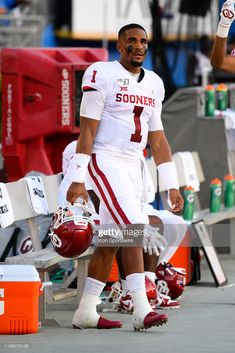Oklahoma Jalen Hurts (QB) looks on from the bench during the college football game between the Oklahoma Sooners and the UCLA Bruins on September at Rose Bowl in Pasadena, CA. Tennessee Volunteers Football, Oklahoma Sooners Football, Nfl Football Teams, Notre Dame Football, Football Parties, Football Football, Football Quotes, Football Stuff, Football University