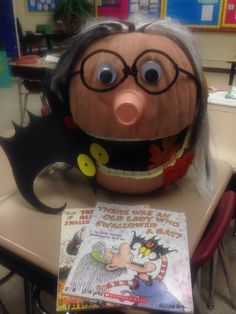 "Storybook character pumpkin.....I haven't seen one of her....""There Was an Old Lady Who Swallowed...""  I did a combination of a bat and some leaves."