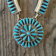 """Indian handmade productGenuine Turquoise Sterling Silver Weighs 2.0 oz.Measures 24 3/4"""" long.  The vintage turquoise cluster necklace is signed Tommy Lowe Nava"""