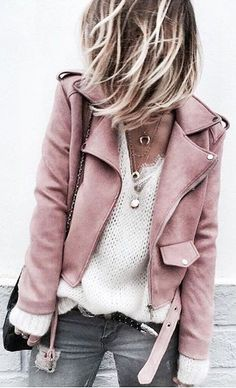 Looks like the kind of jacket you would reach for every time. Reads pink suede, could be leather. No zippers, clean design. Worn over an open knit sweater with layered necklaces and black shoulder bag. Gray jeans. Cool. Style Planet