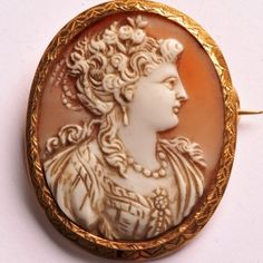 Shell cameo brooch of a woman in profile to the right, white on orange/grey background.  Set in an engraved 18 carat gold frame.  32 x 40mm   www.osprey.fr   €665 Orange Grey, Paris, Gray Background, Carat Gold, Shells, Vintage Jewelry, Profile, Jewels, Collection