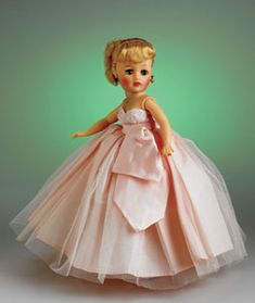 """Classic 10-Inch Revlon Doll - The classic """"Little Miss Revlon"""" has rooted Saran hair and wears a gown made of taffeta and tulle with a lace overlay on the bodice. A very popular doll, she had more than a hundred different outfits in her day!"""