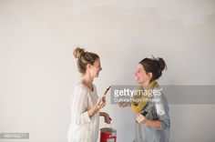 Stock-Foto : Two young women with paintbrushes chatting
