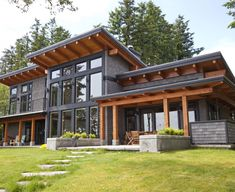 Beautiful A signature West Coast contemporary design, this modern hybrid timber frame home is as beautiful to look at as it is to live in. The post A signature West Coast contemporary design, t . Modern Exterior, Exterior Design, Exterior Colors, Exterior Paint, Black Trim Exterior House, Log Homes Exterior, Mountain Home Exterior, Cafe Exterior, Restaurant Exterior