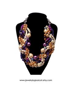 This beautiful Jewelry by Jessica Theresa color combination is once again gaining popularity now that the weather has turned cooler! Purples, ivories, and golds look amazing together in a unique J by JT statement necklace!   ORIGINAL TWISTED Statement Necklace Purple by JewelryByJessicaT,
