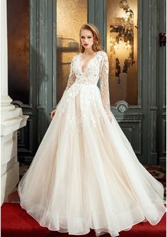 Wedding Dress Sweet Candy ||       Embroidered Princess wedding dress crafted in lace, tulle and organza     Handmade beads fine applications     Deep V necklin     Long cathedral train     Long sleeves with manually lace application     Dress closes in the back with buttons and zipper