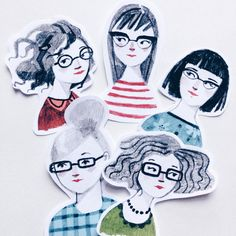 Cutting out some bespectacled lady stickers.