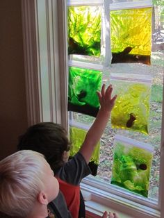 Fill zip lock bags with hair gel from dollar store and add food coloring--blue if you want to make an aquarium. Squish the bags, add plastic, rubber, or foam fish, etc. Tape the bags and hang on window.