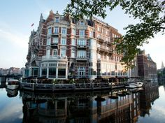 DE L'EUROPE, AMSTERDAM Amsterdam, Netherlands  An 1896 neo-Renaissance landmark on a bend of the Amstel River in central Amsterdam. Owned by Heineken, the 111-room hotel has expanded, following a two-year renovation, into neighboring buildings, including a former bank from the same era.
