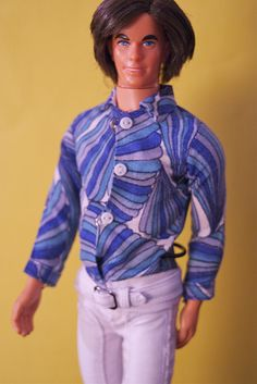 "Vintage Mod Hair Ken.   Why didn't we question if Ken was gay?  We just thought, ""oh sure, all guys wear purple pants and psychedelic shirts ""....???"