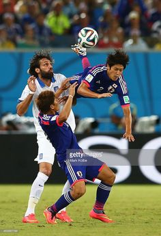 Atsuto Uchida of Japan competes for the ball with Giorgos Samaras of Greece during the 2014 FIFA...