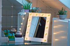 Discover the blogger Clothes and Cameras dressing table and makeup mirror. It's so pretty when the lights on the makeup mirror is on!   #makeupmirrorcom