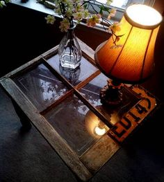 If I am ever in one place long enough to own my own furniture I will make this! (Once again... a treasure from the G-parents old farm. An old old window fixed with a license plate. Turned into a table by adding old table legs! -missi moyer)