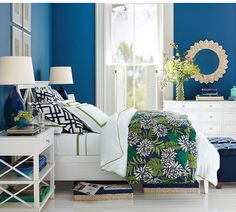 Even in its brightest hues, blue remains one of the most soothing colors for a bedroom. Mix it with bold, graphic patterns, like this green and navy floral print duvet.