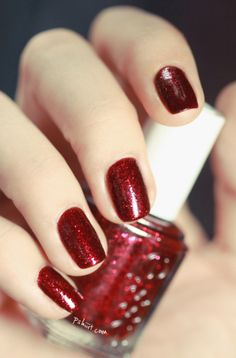 """Leading Lady"" by Essie.   A gorgeous, ruby-red polish that would make Dorothy proud! This polish would add a perfect cranberry pop to any sleek holiday outfit. #lulusholiday"