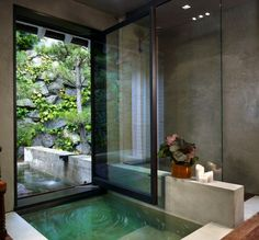 bathroom-1-pool-side-infinity-pool-garret-cord-werner © Garret Cord Werner Design... Ohhh I could think of many variations of this idea... one being being able to swim under the door to outside, and glass roll up garage type door. Love it!